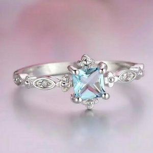 Silver Light Blue Topaz Diamond Milgrain Ring